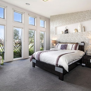 This is an example of a mid-sized transitional master bedroom in Other with white walls, carpet and grey floor.