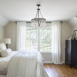 Mid-sized elegant master medium tone wood floor bedroom photo in Minneapolis with beige walls