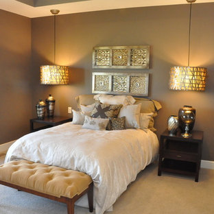 Inspiration for a small arts and crafts master bedroom in Omaha with brown walls and carpet.