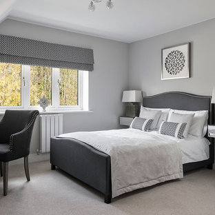 Photo of a classic guest bedroom in Berkshire with grey walls, beige floors and carpet.