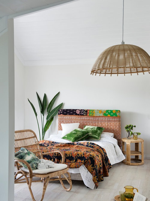 inspiration for a tropical guest light wood floor bedroom remodel in perth with white walls