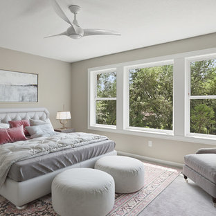 Example of a transitional carpeted and gray floor bedroom design in Minneapolis with beige walls