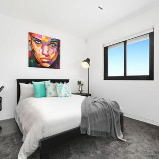 Photo of a mid-sized contemporary master bedroom in Sydney with white walls, carpet and grey floor.