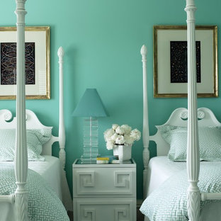 Inspiration for a transitional guest bedroom in New York with blue walls.