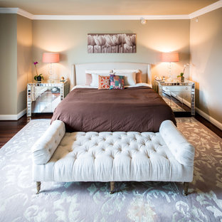 Example of a transitional bedroom design in DC Metro with beige walls