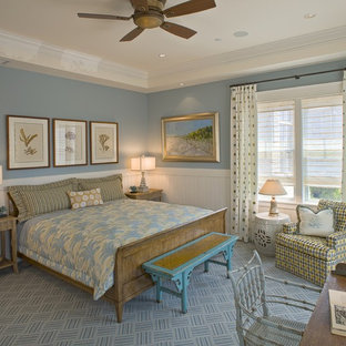 Mid-sized coastal medium tone wood floor and brown floor bedroom photo in Philadelphia with blue walls and no fireplace