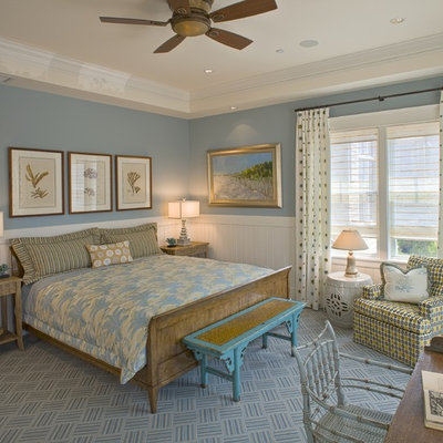 Mid-sized beach style medium tone wood floor and brown floor bedroom photo in Philadelphia with blue walls and no fireplace