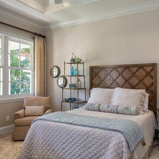 Bedroom - coastal bedroom idea in Miami with beige walls