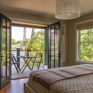 Inspiration for a large arts and crafts master bedroom in Boston with beige walls, medium hardwood floors, no fireplace and brown floor.