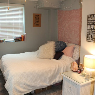 Inspiration for a mid-sized modern guest carpeted and beige floor bedroom remodel in Other with gray walls and no fireplace