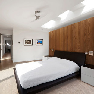 Inspiration for a mid-sized modern master cork floor and beige floor bedroom remodel in Indianapolis with white walls
