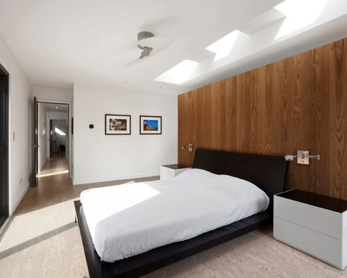 Inspiration for a mid-sized modern master cork floor and beige floor bedroom  remodel in