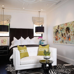 Inspiration for a transitional dark wood floor and black floor bedroom remodel in Los Angeles with white walls