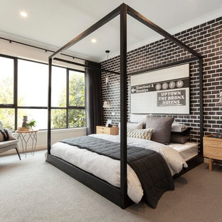 This is an example of an industrial bedroom in Melbourne with black walls, carpet and grey floor.