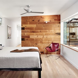 Mountain style guest light wood floor and beige floor bedroom photo in Austin with white walls and no fireplace