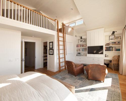 Large Beach Style Loft Style Light Wood Floor And Beige Floor Bedroom Idea  In Orange