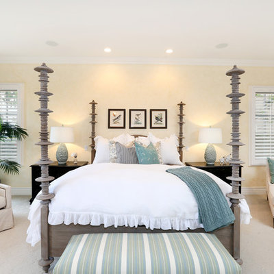 Mid-sized beach style master carpeted bedroom photo in Orange County with yellow walls and no fireplace