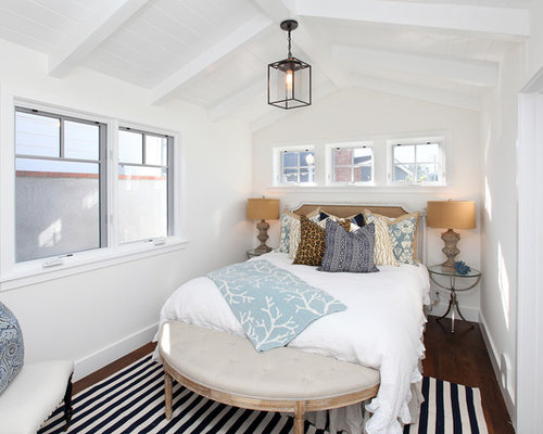 traditional dark wood floor bedroom idea in orange county with white walls