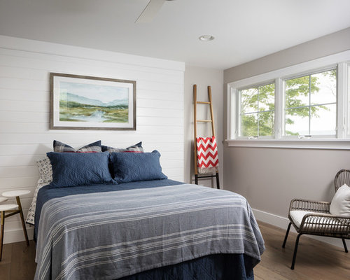 Inspiration For A Large Beach Style Guest Medium Tone Wood Floor And Brown  Floor Bedroom Remodel
