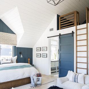 Bedroom - huge coastal master light wood floor and beige floor bedroom idea in Orange County with white walls