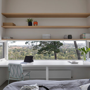 Photo of a modern guest bedroom in Melbourne with white walls.