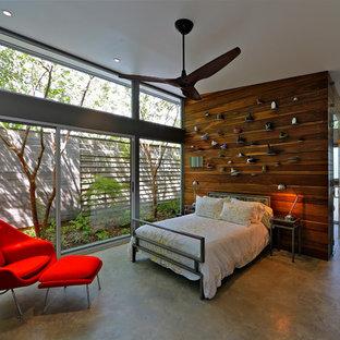 Foto de dormitorio principal, contemporáneo, pequeño, con suelo de cemento