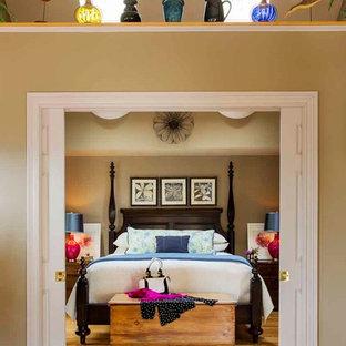 Elegant loft-style light wood floor bedroom photo in Providence with beige walls