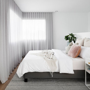 This is an example of a scandinavian bedroom in Melbourne.