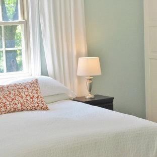 Example of an eclectic bedroom design in Cincinnati with blue walls