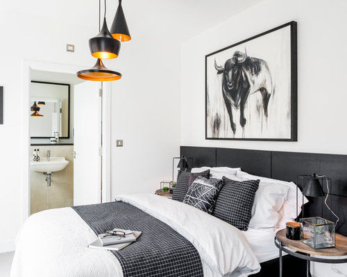 Inspiration for a mid sized industrial master bedroom remodel in Hampshire  with white walls. Best 100 Industrial Bedroom Ideas   Decoration Pictures   Houzz
