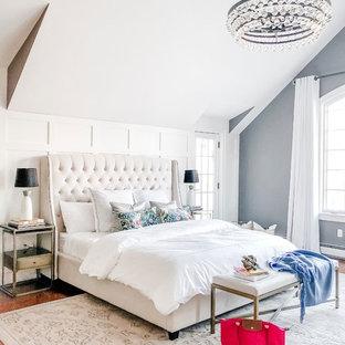 На фото: большая хозяйская спальня в стиле современная классика с паркетным полом среднего тона, стандартным камином, фасадом камина из кирпича, коричневым полом и серыми стенами с