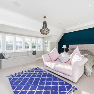 Inspiration for a nautical master bedroom in Hertfordshire with blue walls, carpet and beige floors.