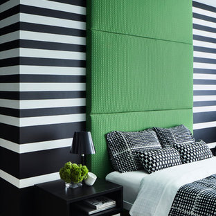 Photo of a contemporary bedroom in New York with multi-coloured walls and light hardwood flooring.