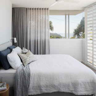 Photo of a contemporary bedroom in Sunshine Coast with white walls, carpet and grey floor.