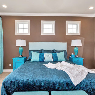 Example of a mid-sized transitional master carpeted bedroom design in Seattle with brown walls