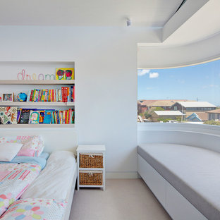 Inspiration for an expansive modern loft-style bedroom in Sydney with white walls and light hardwood floors.