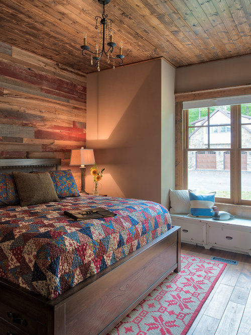 Large rustic medium tone wood floor and brown floor bedroom idea in  Minneapolis with beige walls. Our 11 Best Rustic Bedroom Ideas   Decoration Pictures   Houzz