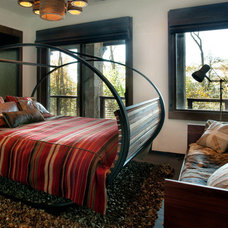 Rustic Bedroom by CMA Design Studio Inc