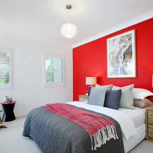 This is an example of a contemporary master bedroom in Sydney with carpet, grey floor and red walls.