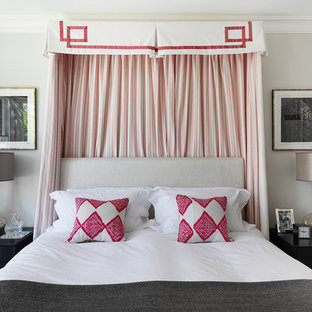 Design ideas for a traditional master bedroom in London with grey walls.