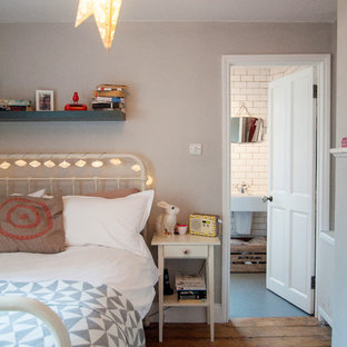 Example of an eclectic bedroom design in London