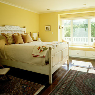 Inspiration for a timeless guest dark wood floor bedroom remodel in Seattle with yellow walls and no fireplace