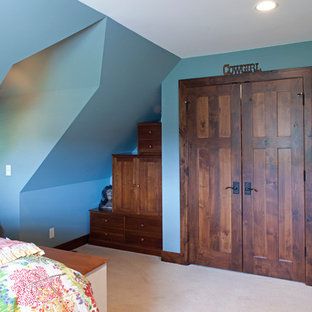 Mid-sized country guest bedroom in Minneapolis with blue walls and carpet.