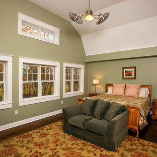 Example of a large classic master medium tone wood floor bedroom design in Other with green walls and no fireplace