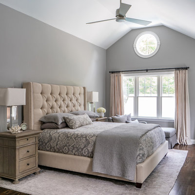 Bedroom - large traditional master dark wood floor and brown floor bedroom idea in Boston with gray walls and no fireplace