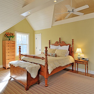 Inspiration for a timeless bedroom remodel in Bridgeport with yellow walls
