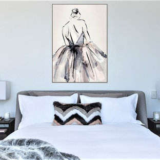 This is an example of a contemporary master bedroom in Sydney with white walls.