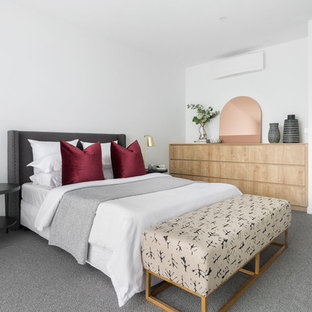 Design ideas for a contemporary master bedroom in Melbourne with white walls, carpet and grey floor.