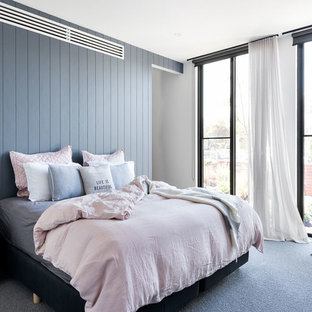 This is an example of a mid-sized contemporary master bedroom in Melbourne with white walls, carpet and grey floor.