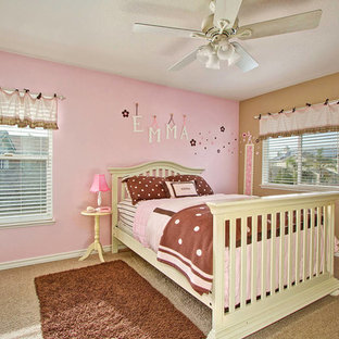 Example of a large transitional carpeted bedroom design in Los Angeles with pink walls and no fireplace